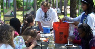 Christine Raabe, Director of the Ocean County Soil Conservation District teaches children about the importance of soil at the Annual Trout in the Classroom day.