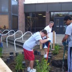 Students planting an outdoor classroom