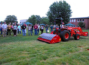 "The Vertiquake machine rolls over an area of poor turf quality, and demonstrates how the use of ground penetrating blades, the soil can be amended while barely disturbing the surface. Photo courtesy of <a href=""http://njaes.rutgers.edu/spotlight/soil-health.asp"" target=""_blank"">Rutgers University</a>."