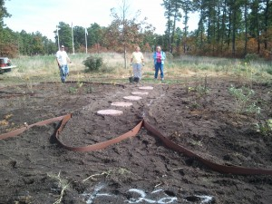 Volunteers plant a garden in the shape of a butterfly for the SHiP Project at Jake's Branch County Park. This garden includes native plants that will attract butterflies, among other beautiful wildlife.